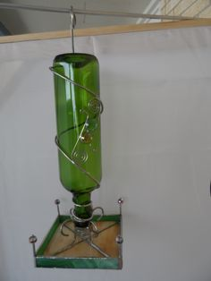 Stained glass and wine bottle bird feeder. Available at Jitter Beans Coffee in Mineral Wells Texas.