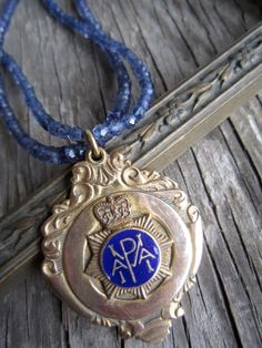 Cricket club gold tone and enameled fob on double by susanruppel1, $95.00  #vintage recycled necklace #vintage medal necklace #vintage cricket club medal # iolite necklace #susan ruppel designs #cricket club fob