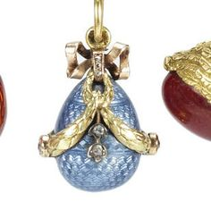 A two-colour gold, jewelled and enamel miniature pendant egg by Fabergé workmaster Feodor Afanassiev, St. Petersburg, circa 1900, the blue guilloché body applied with diamond-set ribbon-tied swags.
