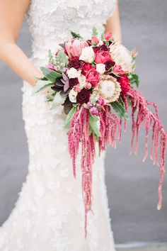 bouquet with amaranthus - photo by FreeHope Photography http://ruffledblog.com/romantic-bohemian-wedding-ideas #weddingbouquet #bouquets