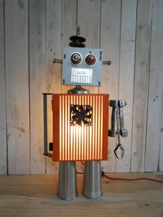 lamp robot made with recycled parts in lights with Upcycled Robots Recycled Metal Light DIY Recycled Lamp, Recycled Robot, Repurposed, Diy Robot, Robot Art, Metal Robot, Found Object Art, Junk Art, Recycle Plastic Bottles