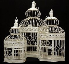 """Decorative """"Antique"""" Bird Cages All 3 cages are the same style. They are painted eggshell cream white over metal. They have a shabby chic or antiqued look. Large Cage measures 13"""" wide x 21"""" tall. Medium birdcage measures 9"""" wide x 18"""" tall. Smallest birdcage measures 7"""" wide x 14"""" tall. $37.00"""