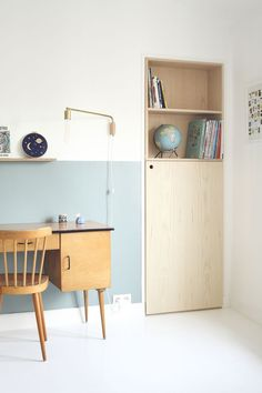 Pretty pastel office space with half painted blue wall, blond woods and Scandinavian vibe