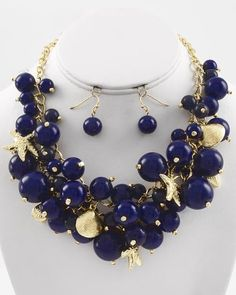 "CHUNKY DEEP MONTANA BLUE BEAD WITH STARFISH AND SHELL GOLD TONE NECKLACE SET     * If you need a necklace extender I have them for sale in my store.*         NECKLACE: 17"" L + EXT    DROP: 1 3/4"" LONG       HOOK EARRINGS: 1"" LONG           COLOR: GOLD TONE  $24.99"
