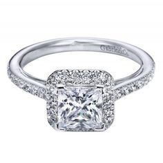18kt white gold princess halo engagement ring with vintage inspired details underneath the crown. So pretty, you have to see it in person!