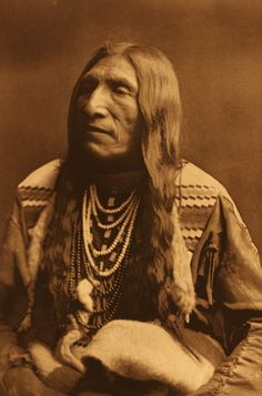Double Runner - Piegan - 1900 Curtis Caption : Double Runner's is an excellent type of the Piegan physiognomy, as well as the ideal North American Indian as pictured by the average person. The native name of this individual is  Ahjutomahka.