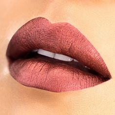 Holy pigmentation! Look at the amazing metallic color from the shade Matterialistic. Get your hands on our Limited Edition Amore Mattallics Lip Crèmes before they're gone! Photo Credit: @thecinemascoper  Shown: Limited Edition Amore Mattallics Lip Crème in Matterialistic  #milani #milanicosmetics #amoremattallics #lipcreme #lipstick #liquidlipstick #mattelipstick #matte #metallic #swatch #lips