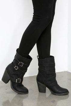 "If you've been wondering what your newest boots are gonna look like, we'll give you a hint: they're the Madden Girl Kloo Black Buckled Mid-Calf Boots! These awesome vegan leather boots are an easy choice to make, with an almond-toe, and three silver-buckled straps around the 7.5"" two-piece shaft."