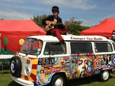 "Oh, yeah! Check out this Dub dude on top of his psychedelic VW camper. BBC Boracay says: "" The Who meet Jimi Hendrix..Sound of Silence!"""