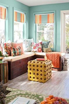 BETTER HOMES AND GARDENS-Good lighting, and the right furniture and colorful accessories, make a small sunroom seem roomy.