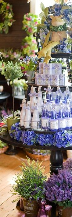Beautiful display using color. Love how the product color matches the flowers used as props.