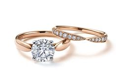 Tiffany Harmony™ solitaire diamond engagement ring in rose gold, with a matching rose gold wedding band with diamonds.