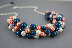 Coral and Navy Necklace, Navy Coral Pearl Necklace, Bridesmaid Jewelry, Bridesmaid Necklace, Cluster Necklace, Coral Necklace, Coral Wedding by DaisyBeadzJoaillerie on Etsy https://www.etsy.com/ca/listing/228559770/coral-and-navy-necklace-navy-coral-pearl