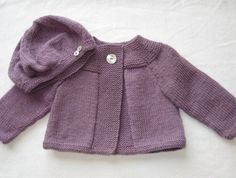 Daisy Swing Cardigan and Cheeky Beret Set....100% pure wool.  Grape colour. Size 0-6 months.  Features long sleeves, large Mother of Pearl button to fasten.   Hand knitted by me. The perfect gift for a friend, family or for your own wee one. I would love to help with any requests, if you require a l...