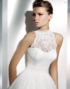 2013 Wedding Trends: Wedding Dresses with High Necklines ...now all they need are long sleeves, and I'll be happy.  ;)