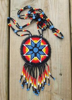 This Native american beaded rosettes strips headbands are