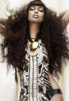 Black woman with long hair and and body adornment
