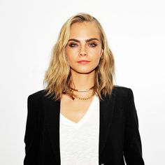 Cara Delevingne's short hair with bold brows and a smokey eye is stunning
