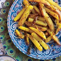 Spiced Potatoes (Aloo Bhaji) - Art dealer Surajit Bomti Iyengar serves these tender potato sticks for brunch at his Calcutta apartment. The potatoes are cooked with panch phoron, or Bengali five-spice powder—a mix that includes fennel, cumin and mustard seeds—then tossed with turmeric.| Food & Wine