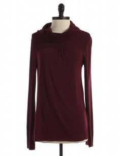 Check it out! DKNY, Size M. Priced at $64.95.