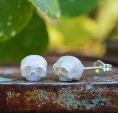Hand carved pearl skull earrings