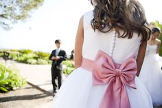 or maybe a white dress with pink accent like a bow