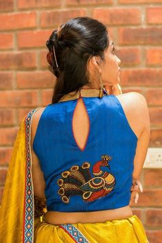Buy House Of Blouse Blue raw silk high neck blouse online in India at best price.DESCRIPTION: A cool high neck deep sleeveless blouse in blue raw silk with amazing details worked in Blouse Back Neck Designs, High Neck Blouse, Fancy Blouse Designs, Blue Blouse, Sleeveless Blouse, Saree Blouse Patterns, Saree Blouse Designs, Blouse Styles, Choli Designs
