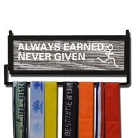 Our exclusive wall hanger featuring our Rustic Always Earned design is made from hand-forged steel and features a customized printed wood insert.