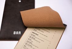 Imagine the smell and feel of this leather bound menu. Classy.