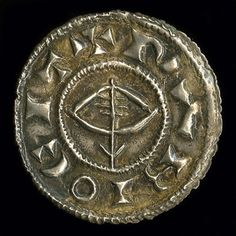 "A Viking penny with an image of Thor's hammer with a ""Hand of God"" resting on top on the reverse, and a drawn bow and arrow (possibly a misrepresentation of a ship) on the front. Cast out of silver. Made in 920 at the mint of Regnald, the Viking king at York. Currently held at the British Museum"