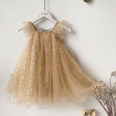 like a jar of summer lightening bugs, this sparkly golden dress is airy and glittery Light golden tulle speckled with gold dots flutter sleeves and square neckline Open back with silver bow tie knee length dress Fireflies Dress Frocks For Girls, Kids Frocks, Dresses Kids Girl, Cute Dresses, Kids Outfits, Cheap Dresses, Girls Gold Dress, Lace Dress For Kids, Baby Girl Frocks