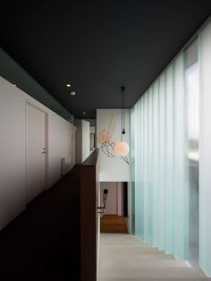 Three Parts House is an alteration and addition to a clinker brick residence on a 1200 sqm block of land. The house is programmatically and conceptuall. Large Bathtubs, Hotel Corridor, Glass Brick, Space Architecture, Architect House, New Home Designs, Hanging Lights, Ideal Home, House Design
