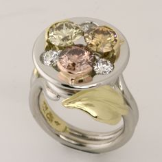 Platinum and 18ct yellow, rose and green gold ring consisting of a Fancy Brown Yellow EightStar Diamond, a Fancy Brownish Greenish Yellow EightStar Diamond, a Fancy Brown Pink EightStar Diamond and three white EightStar Diamonds.