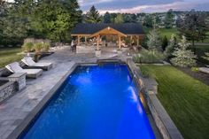 Outdoor living with Umbriano pavers and Rivercrest Wall Pergola