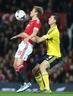 James Wilson of Manchester United in action with Daniel Ayala of Middlesbrough during the Capital One Fourth Round match between Manchester United...