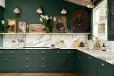 Emerald kitchen cabinets and marble counters