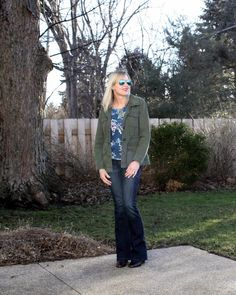 Utility jackets look great with feminine pieces like a floral top and up the chic factor. Doused in Pink blog.