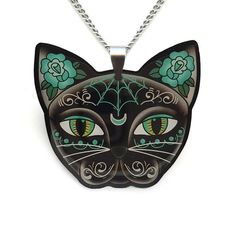 Slinky... Mysterious... Elegant...  Every girl should have a little black cat... This cute necklace is designed and made by Jubly-Umph