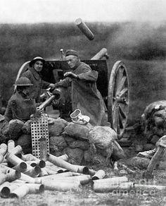 An American gun crew fires a 75mm gun at Saint-Mihiel, France. Photograph, September 1918.