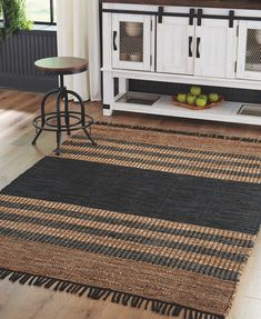 Woven with recycled leather strips, cotton and jute, the Zoran striped area rug invites you to go natural. Flirty fringe adds just enough flair. Posh palette of black and brown makes such a cool understatement. Room Rugs, Rugs In Living Room, Medium Rugs, French Country Kitchens, Recycled Leather, Large Rugs, Signature Design, Online Home Decor Stores, Online Shopping