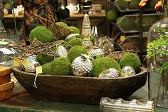 moss and pinecone centrepiece >> loving the mix of silver with earthy textures