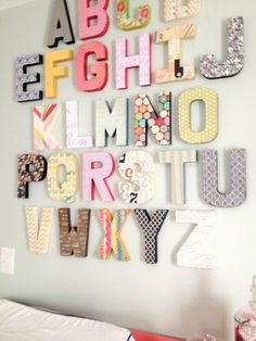 Modge Podge cardboard letters from Hobby Lobby with scrapbook paper to create a one of a kind Alphabet Wall.
