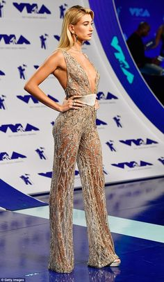 Taking the plunge: Hailey wowed in a plunging sheer jumpsuit adorned with glittering sequins