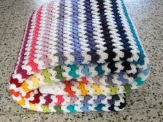Crochet granny stripe blanket. Love the use of white!