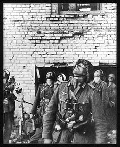 RUSSIA: German troops anxiously scour the rafters of a ruined building in Stalingrad, with the possibility of booby-traps or even a concealed sniper - pin by Paolo Marzioli German Soldiers Ww2, German Army, Bataille De Stalingrad, Eastern Front Ww2, Battle Of Stalingrad, Military Cemetery, Soviet Army, National Archives, Red Army