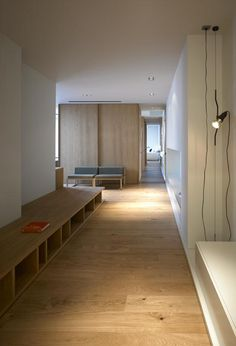 Storage used as reading nook seating in a wide corridor // francesc rifé / blu hotel, almansa