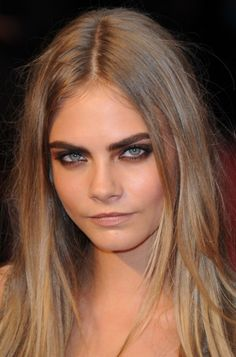 Gorgeous Cara Delevingne. Loving the ashy, messy dark blonde with a chocolate smokey eye, clean skin and a dramatic brow.