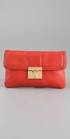 tory burch has really cute clutches this season- lots of nice envelopes and fold overs.  This color is really nice and goes great with camel.