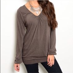 Rich Mocha Banded Hemline Top V-neck. Banded hemline. Long sleeves. Color is Rich Mocha. Very soft and lightweight thus can be worn year round. One size fits most - from women's size small to smallish large. Will not fit women's large properly. Fabric: 45% rayon, 45% polyester, 6% nylon, 4% spandex. Made in U.S.A.. Brand new with attached tag. No trades, no holding, no offsite payment. *~*PRICE IS FIRM UNLESS BUNDLED*~* Tops