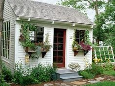 Cottage Industry: Garden Sheds Just about perfect, but it needs a little porch with a roof! A couple chairs, a small table, margaritas to share and there you have it!